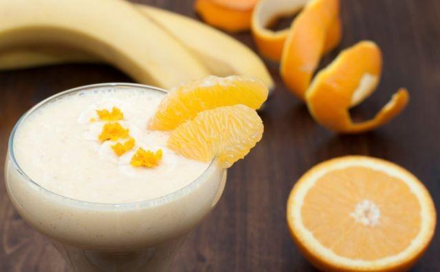 Cocktail of banana with orange and yogurt.