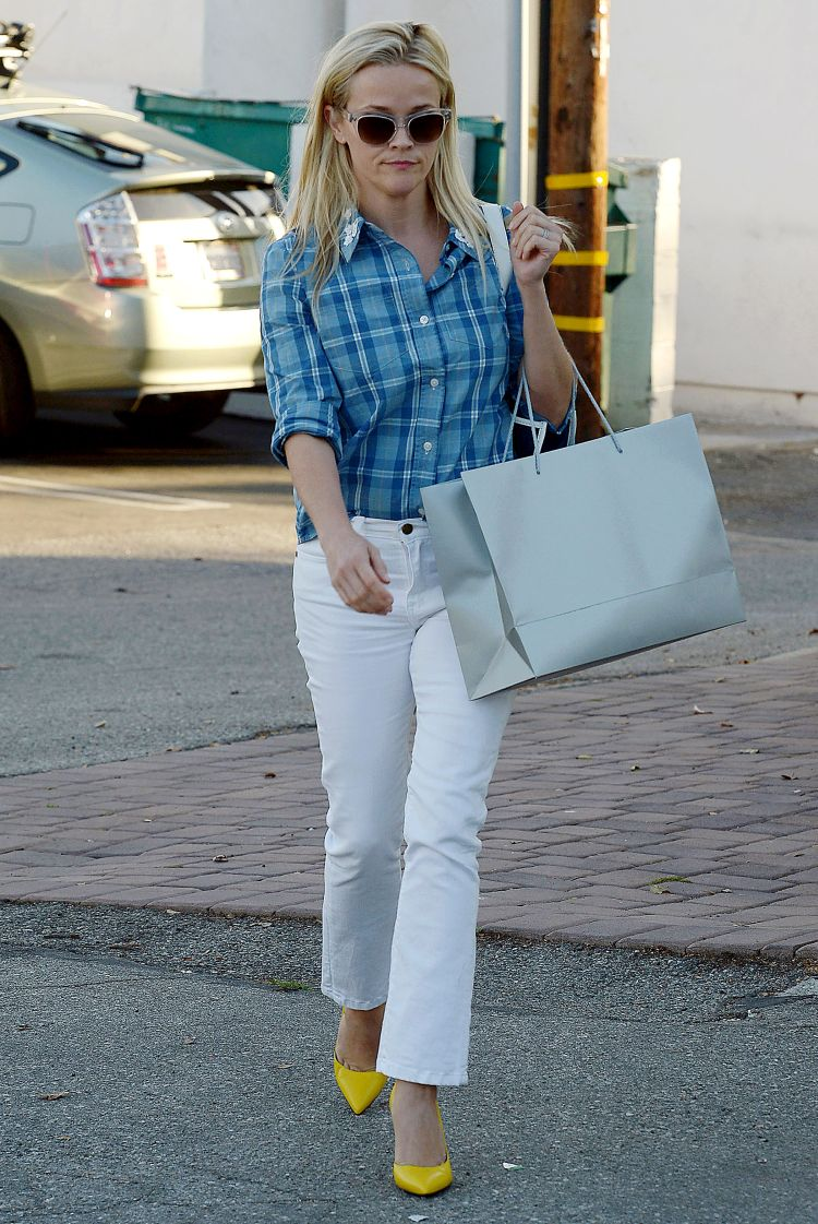 Totes Y'all! Reese Witherspoon is casual cool in a patterned blue top tucked into white jeans while going to Beauty Park Medical Spa in Santa Monica