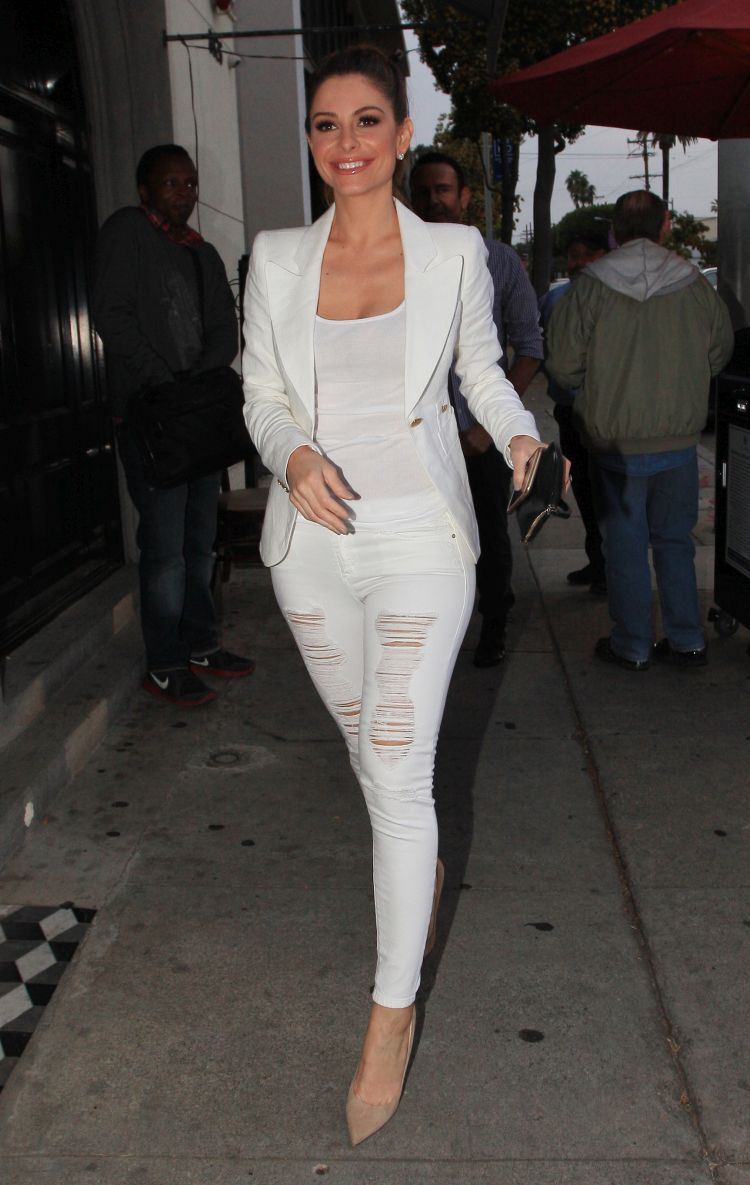 Maria Menounos looks very fashionable in a white blazer and top with white ripped jeans as she heads in for a dinner date with fiancé Keven Undergaro at Craig's in West Hollywood, CA