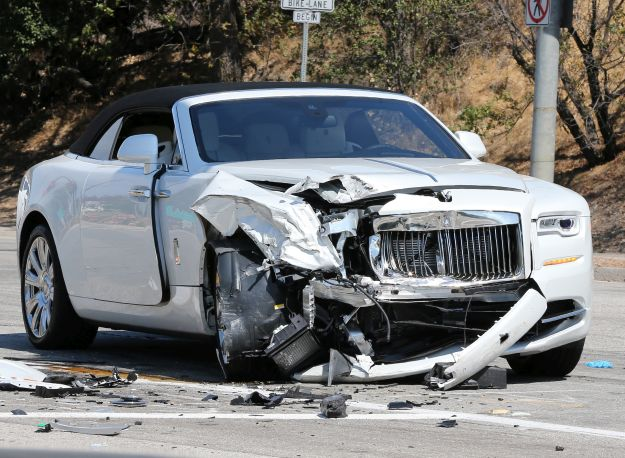 Scene from Kris Jenner car crash in Calabasas in her white Rolls-Royce into a green Prius
