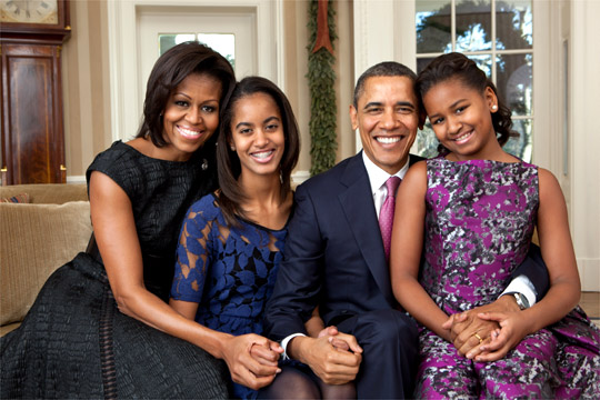 President Barack Obama, First Lady Michelle Obama, and their daughters, Sasha and Malia, sit for a family portrait in the Oval Office, Dec. 11, 2011. (Official White House Photo by Pete Souza)This official White House photograph is being made available only for publication by news organizations and/or for personal use printing by the subject(s) of the photograph. The photograph may not be manipulated in any way and may not be used in commercial or political materials, advertisements, emails, products, promotions that in any way suggests approval or endorsement of the President, the First Family, or the White House.Ê