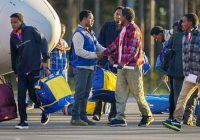 Eritrean asylum seekers arrive by an Italian Financial police aircraft to Lulea Airport, Kallax northern Sweden, Friday, Oct. 9, 2015. Italy bid farewell Friday to 19 Eritreans ó the first of an estimated 160,000 refugees to be resettled throughout Europe as part of a new EU redistribution program to move asylum-seekers out of hard-hit front-line countries. Bundled up in flannel shirts and jackets to prepare for their new lives in Sweden they landed in Lulea, just south of the Arctic Circle. Swedish officials now must register the refugees and begin processing their asylum requests. Sweden's immigration agency said the 14 men and five women, who ranged from 25 to 40 years old, were selected because they have a chance of being granted asylum and have family or other connections to Sweden. (Robert Nyholm/TT via AP)    SWEDEN OUT