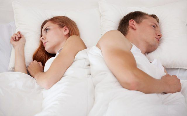 bigstock-couple-lying-back-to-back-74015698