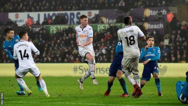 Ливерпул убедлив на гостувањето кај Хадерсфилд, Арсенал потопен кај Свонси